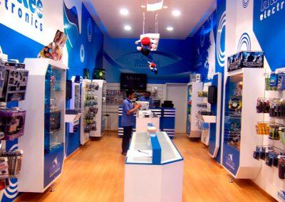 HUSKEE ELECTRONICS • Local Centro Comercial Hayuelos